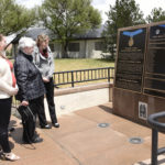 PETERSON AIR FORCE BASE, Colo. – Terry Chapman, mother of Master Sgt. John Chapman, and family members look at his name etched upon the Medal of Honor memorial May 20, 2019 at the Peterson Air and Space Museum. Sergeant Chapman's name is memorialized along with 62 of his fellow heroic Airmen, for all who live, work or visit Peterson AFB to see. (U.S. Air Force photo by Staff Sgt. Alexandra M. Longfellow)
