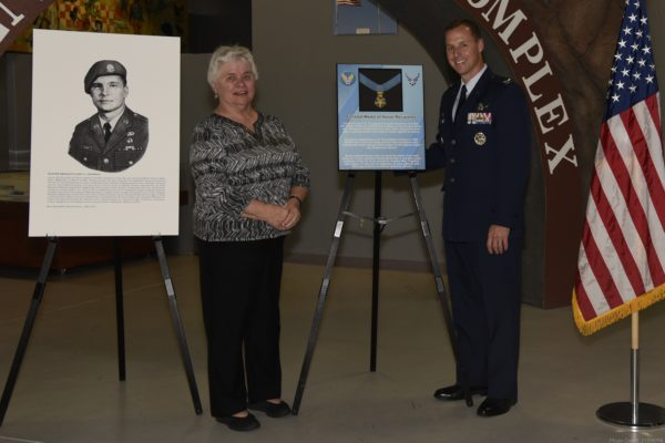 PPETERSON AIR FORCE BASE, Colo. – Terry Chapman (left), mother of Master Sgt. John Chapman, and Col. Todd Moore (right), 21st Space Wing commander, stand next to the Medal of Honor recipient plaque at the Peterson Air and Space Museum on May 20, 2019. The ceremony was held to commemorate the valor and service of Sergeant Chapman, the U.S. Air Force's newest Medal of Honor recipient. (U.S. Air Force photo by Staff Sgt. Alexandra M. Longfellow)