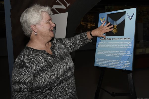 PETERSON AIR FORCE BASE, Colo. – Terry Chapman, mother of Master Sgt. John Chapman, touches the Medal of Honor after a ceremony at the Peterson Air and Space Museum, May 20, 2019. She had never touched her son's official Medal of Honor, as the medal was given to Chapman's wife. She received the Medal of Honor flag. (U.S. Air Force photo by Staff Sgt. Alexandra M. Longfellow)