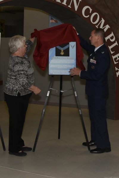 PETERSON AIR FORCE BASE, Colo. – Terry Chapman (left), mother of Master Sgt. John Chapman, and Col. Todd Moore (right), 21st Space Wing commander, unveil the Medal of Honor recipient plaque at the Peterson Air and Space Museum on May 20, 2019. Sergeant Chapman was posthumously awarded the Congressional Medal of Honor for his actions in the Battle of Takur Ghar. (U.S. Air Force photo by Staff Sgt. Alexandra M. Longfellow)